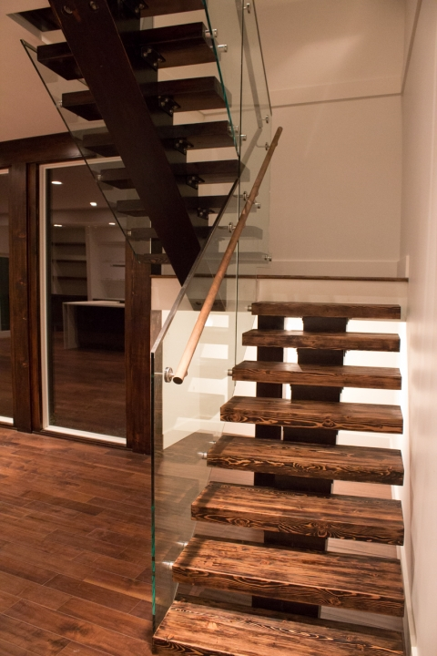 Modern custom home floating stairs built by Balmoral Construction Whistler